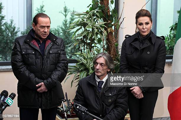 Italian Prime Minister Silvio Berlusconi and Italian politician Daniela Santanche face media alongside Alberto Torregiani, the son of Pierluigi...