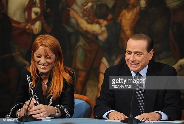 Italian Prime Minister Silvio Berlusconi and minister for tourism Michela Vittoria Brambilla give a joint press conference on June 3 2009 at Palazzo...