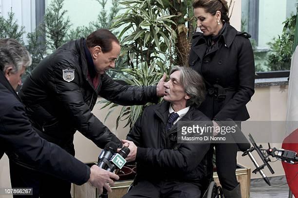 Italian Prime Minister Silvio Berlusconi and politician Daniela Santanche greets Alberto Torregiani, the son of Pierluigi Torregiani, as they face a...