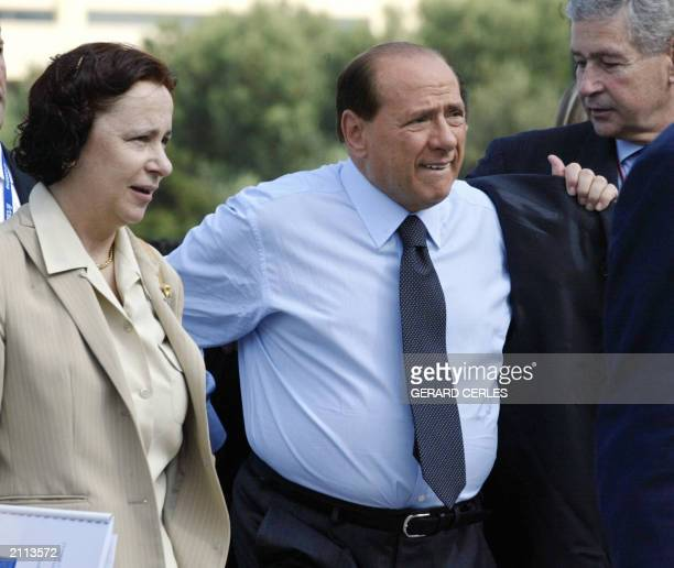 Italian Prime Minister Silvio Berlusconi and Spanish Foreign Minister Ana Palacio arrive to the EUWest Balkan Summit at Porto Carras near...