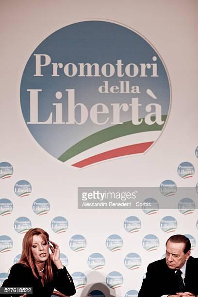 Italian Prime Minister Silvio Berlusconi and talian Tourism minister Michela Vittoria Brambilla gesture during a meeting to promote a candidates for...
