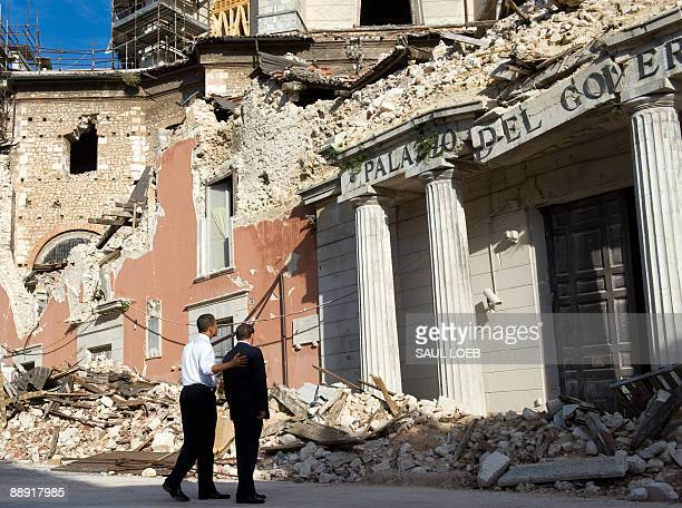 Italian Prime Minister Silvio Berlusconi and US President Barack Obama look at a damaged government building, destroyed by an April 2009 earthquake...