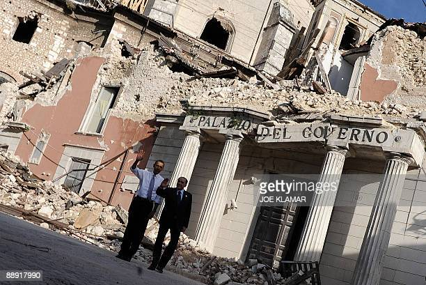 Italian Prime Minister Silvio Berlusconi and US President Barack Obama look at the damaged Palazo del Governo, destroyed by an April 2009 earthquake...
