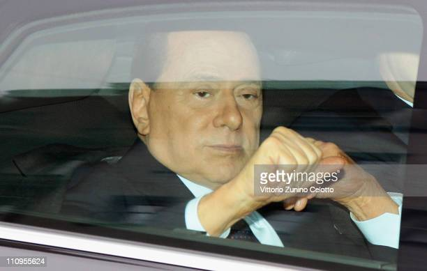 Italian Prime Minister Silvio Berlusconi arrives at the preliminary hearing of the Mediatrade case at court on March 28 2011 in Milan Italy...