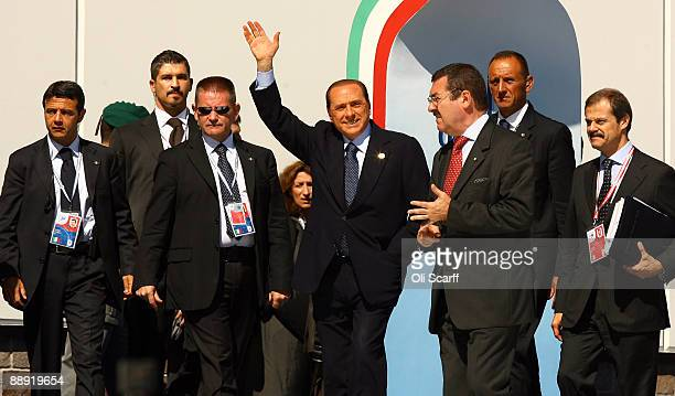 L'AQUILA ITALY JULY 09 Italian Prime Minister Silvio Berlusconi arrives with his entourage for a meeting with the leaders of the other G8 nations on...