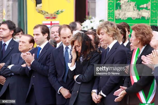 Italian Prime Minister Silvio Berlusconi Bongiorno's sons Lorenzo and Michele alongside Bongiorno's wife Daniela Zuccoli Leonardo Bongiorno and the...