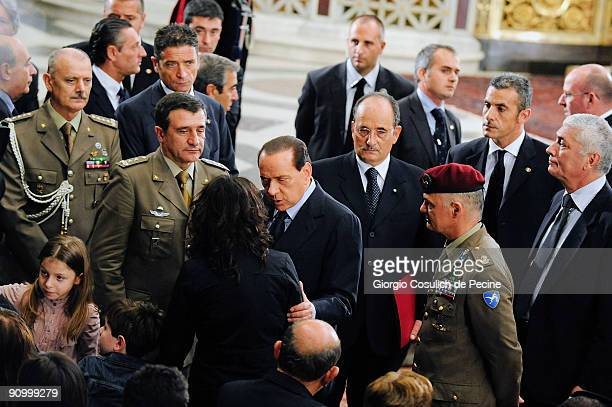 Italian Prime Minister Silvio Berlusconi comforts relatives of the six Italian soldiers of the Natoled International Security Assistance Force during...