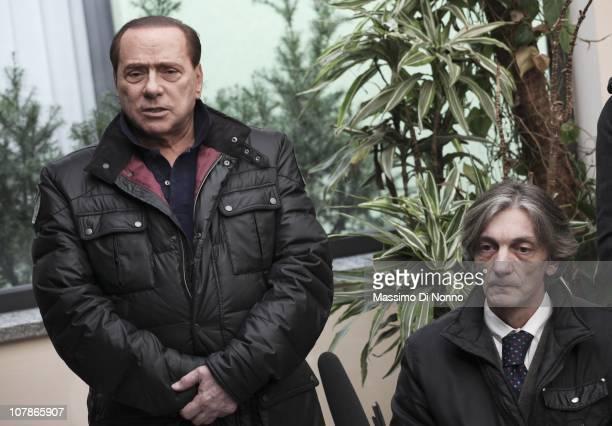 Italian Prime Minister Silvio Berlusconi faces a media gathering alongside Alberto Torregiani, the son of Pierluigi Torregiani, at Linate military...