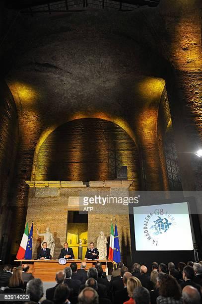 Italian Prime Minister Silvio Berlusconi flanked by Italian Foreign Minister Franco Frattini and the head of the Civil Protection Guido Bertolaso...