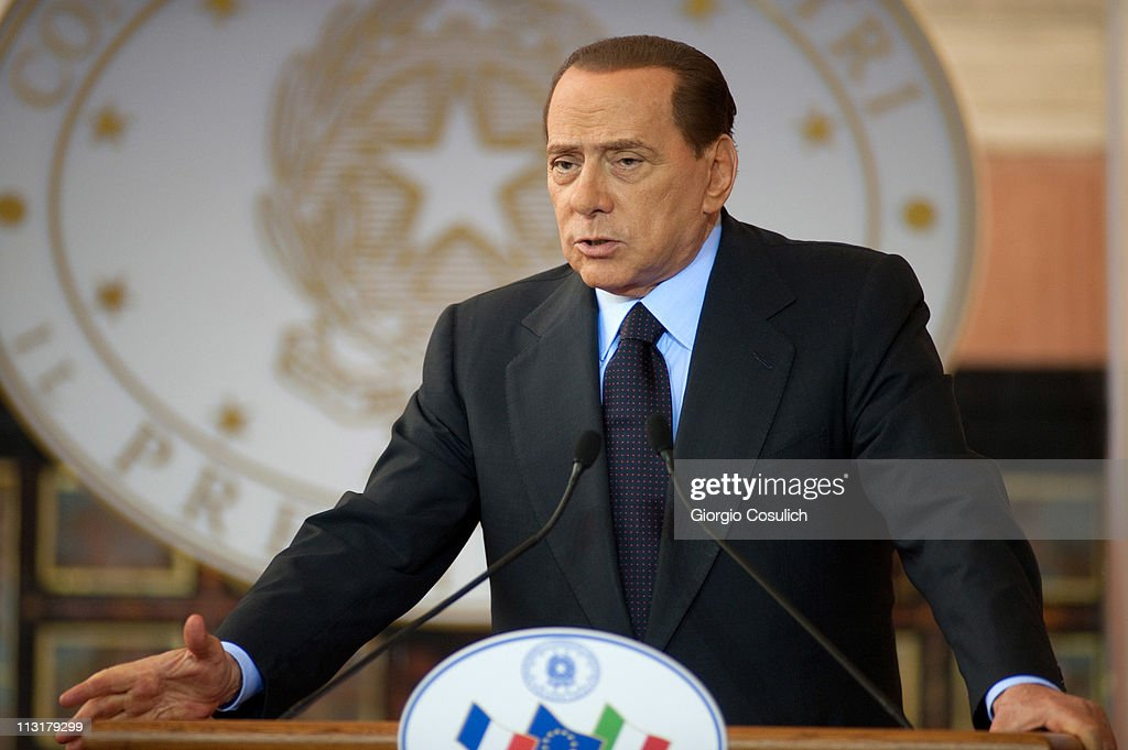 Italian Prime Minister Silvio Berlusconi gestures as he attends the Italy-France Summit with French President Nicolas Sarkozy at Villa Madama on April 26, 2011 in Rome, Italy. The two leaders discussed the immigration crisis and the possible opening of nuclear power plants among other topics during the Italy-France summit.