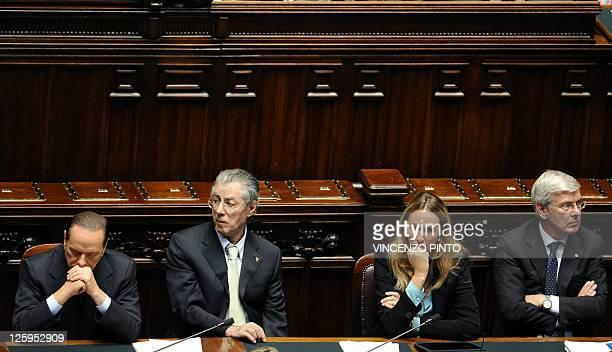 Italian Prime Minister Silvio Berlusconi gestures next to Reforme Minister Umberto Bossi , Environment Minister Stefania Prestigiacomo and Economic...
