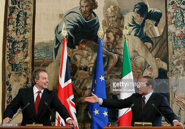 Italian Prime Minister Silvio Berlusconi greets British counterpart Tony Blair before a press conference at Chigi palace May 27, 2005 in Rome, Italy....