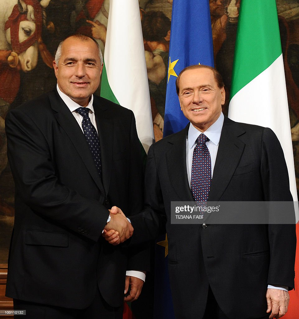 Italian Prime Minister Silvio Berlusconi greets his Bulgarian counterpart Boyko Borisov prior to their meeting on May 21, 2010 at Palazzo Chigi in Rome. AFP PHOTO/ Tiziana Fabi .