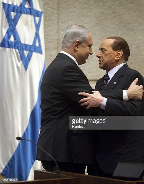 Italian Prime Minister Silvio Berlusconi greets Israeli Prime Minister Benjamin Netanyahu before his speech in the Knesset on February 03 2010 in...
