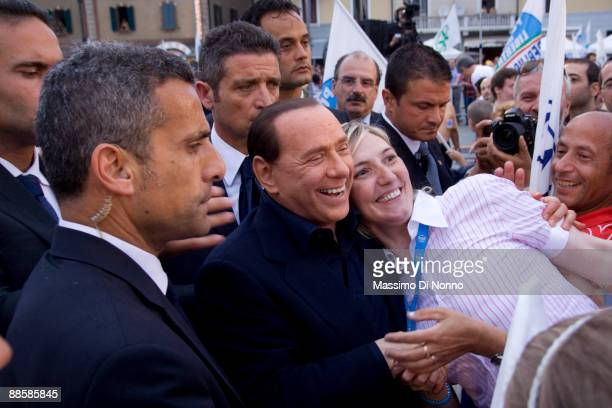 Italian Prime Minister Silvio Berlusconi is greeted by well wishers during the closing rally of the Partito della Liberta political campaign for...