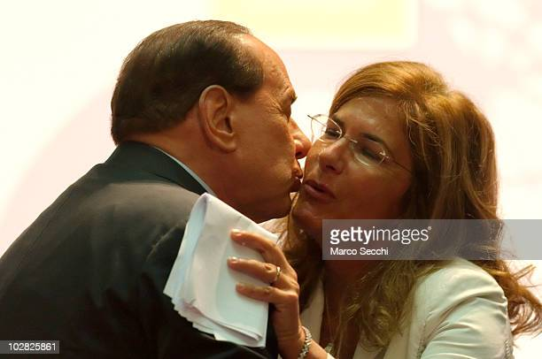 Italian Prime Minister Silvio Berlusconi kisses Emma Marcegaglia president of Confindustria after her speach at the opening session of the Med Forum...