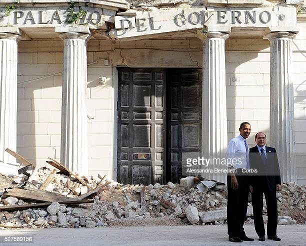 Italian Prime Minister Silvio Berlusconi leads US President Barack Obama on a tour of buildings destroyed by an April 2009 earthquake in the city...