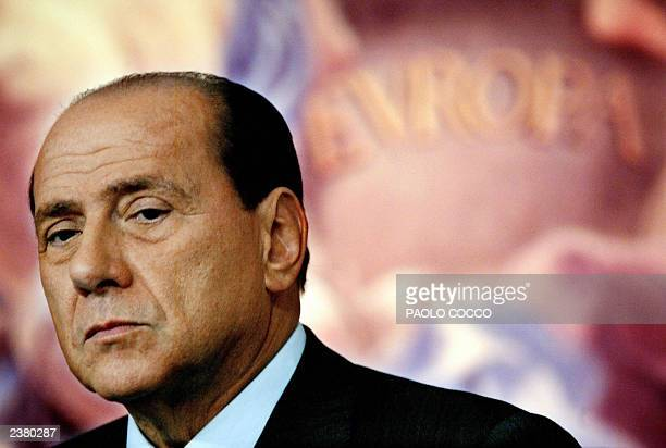 Italian Prime Minister Silvio Berlusconi listens to a journalist's question during a joint news conference with Chairman of the European Parliament...