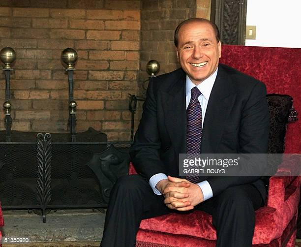 Italian Prime Minister Silvio Berlusconi poses in Villa Madama an official residence in Rome 20 February 2002 during the visit of Syrian President...