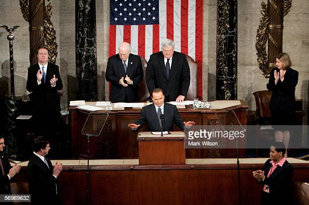 Italian Prime Minister Silvio Berlusconi reacts to applause as he arrives in the chamber of the U.S. House of Representatives at the U.S. Capitol for...