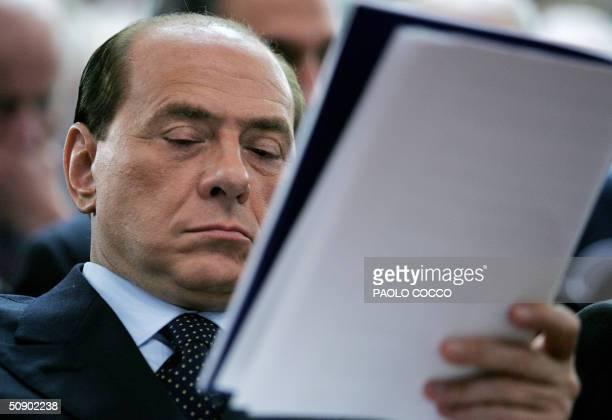 Italian Prime Minister Silvio Berlusconi reads Ferrari's president Luca Cordero di Montezemolo's speech at the Confindustria, the Confederation of...