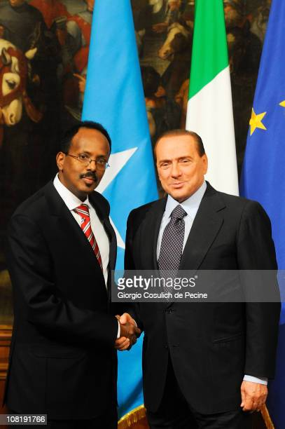 Italian Prime Minister Silvio Berlusconi shakes hands with Somalian Prime Minister Mohammed Abdullahi Mohammed during a meeting at Palazzo Chigi on...
