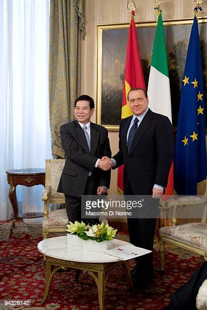 Italian Prime Minister Silvio Berlusconi shakes hands with Vietnamese President Nguyen Minh Triet on December 11 2009 in Milan Italy The two...
