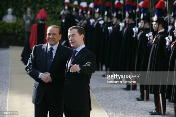 Italian Prime Minister Silvio Berlusconi shakes hands with visiting Russian President Dmitry Medvedev at Villa Madama on December 3, 2009 in Rome,...