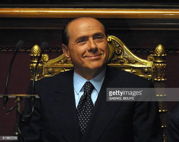 Italian Prime Minister Silvio Berlusconi smiles before an address to the upperhouse Senate in Rome 18 june 2001 Berlusconi was expected to raise...