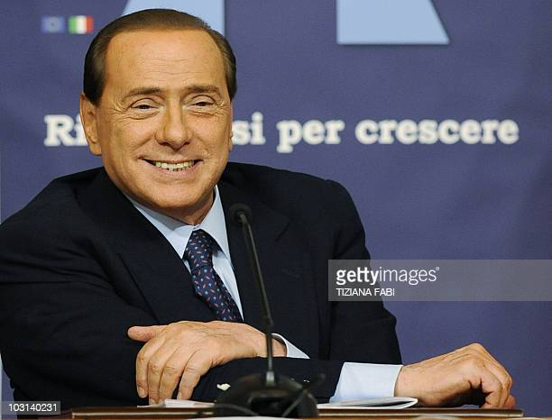 Italian Prime Minister Silvio Berlusconi smiles during a conference of Italian Ambassadors on July 28 2010 at Farnesina Palace in Rome AFP PHOTO/...