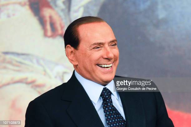 Italian Prime Minister Silvio Berlusconi smiles during a press conference to present new government measures for the youngsters, called 'Right To The...