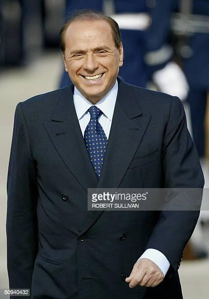 Italian Prime Minister Silvio Berlusconi smiles during arrival ceremonies 08 June 2004 at Hunter Army Airfield in Savannah Georgia Berlusconi is...