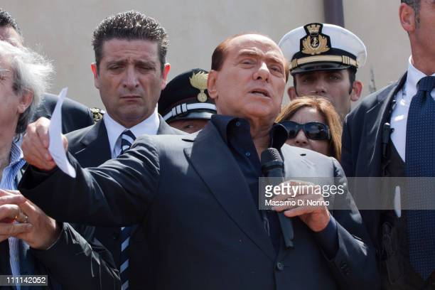 Italian Prime Minister Silvio Berlusconi speaks as he assures the public that the newly arrived migrants will be removed within 60 hours on March 30...