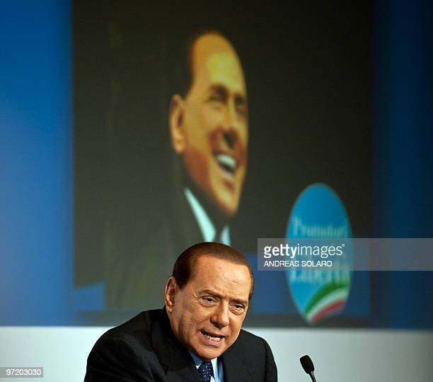 Italian Prime Minister Silvio Berlusconi speaks during a meeting as he promotes a candidate for the next regional elections at Temple of Hadrian in...