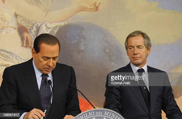 Italian Prime Minister Silvio Berlusconi speaks next to Italy's civil protection department chief Guido Bertolaso during a press conference following...