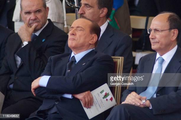 Italian Prime Minister Silvio Berlusconi takes a nap beside Italian President Senate Renato Schifani while attenting the military parade to mark the...