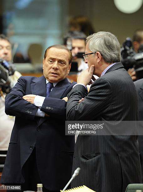 Italian Prime Minister Silvio Berlusconi talks to Luxembourg Prime Minister JeanClaude Juncker at the start of a summit of the EU heads of State on...
