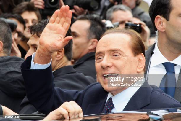 Italian Prime Minister Silvio Berlusconi waves after the preliminary hearing of the Mediatrade case at court on March 28 2011 in Milan Italy...