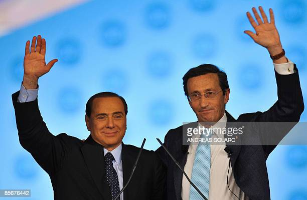Italian Prime Minister Silvio Berlusconi waves to supporters with President of the Italian Parliament Gianfranco Fini former Leader of National...