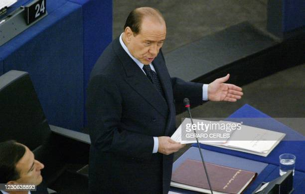 Italian Prime Minister Silvio Berlusconi, whose country currently holds the EU presidency, speaks at the European Parliament during a plenary session...