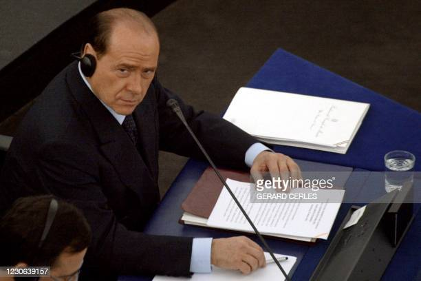 Italian Prime Minister Silvio Berlusconi, whose country currently holds the EU presidency, listens to talks at the European Parliament during a...