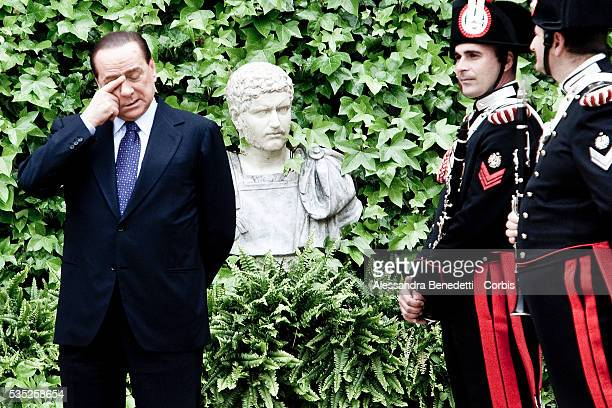 Italian Prime Minister Silvio Berlusconi wipes away his eyes priot a meeting with Emir of Kuwait Sheikh Sabah AlAhmad AlJaber at Villa Madama