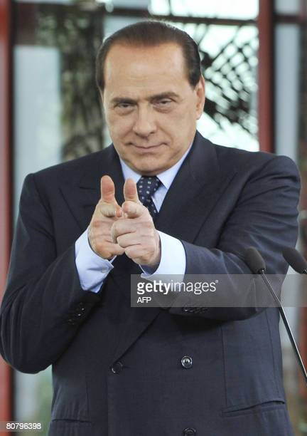 Italian Prime Minister-elect Silvio Berlusconi gestures during a joint press conference with outgoing Russian President Vladimir Putin at...