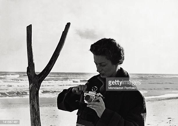 Italian princess Marella Caracciolo di Castagneto Agnelli handling a camera 1960s