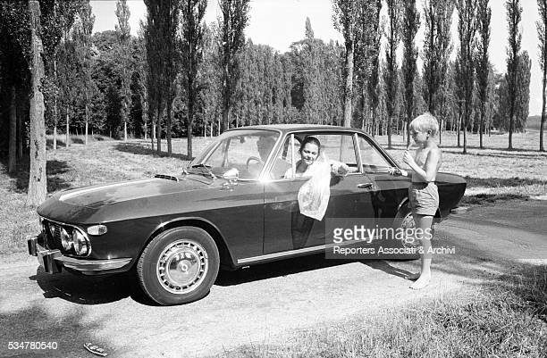 Italian princess Maria Pia of Savoy in a car with one of her four children Italy 1965