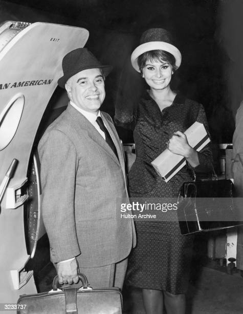 Italian producer Carlo Ponti and his wife Italian actress Sophia Loren depart for Rome to attend premieres of the film 'Two Women' for which she won...