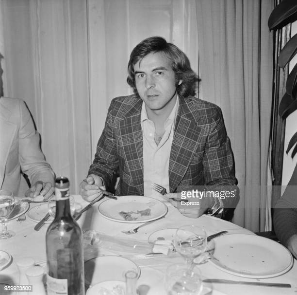 Italian professional footballer and midfielder with A S Roma football club Giorgio Morini pictured eating a meal in a restaurant in London on 13th...