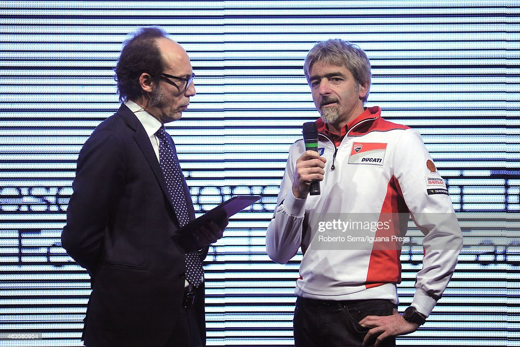 Italian project manager and engineer Luigi Dall'Igna (R) and journalist Guido Meda unveil the Ducati Desmosedici Moto GP 2015 Championship at Ducati Factory on February 16, 2015 in Bologna, Italy.