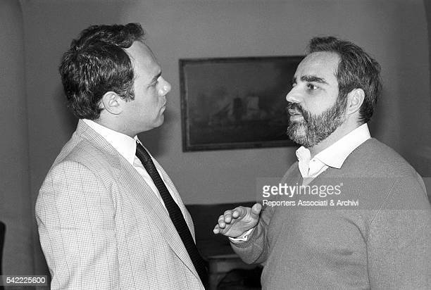 Italian publisher and entrepreneur Angelo Rizzoli talking to Italian actor and director Carlo Verdone at Premio Ischia ceremony Ischia 10th May 1982