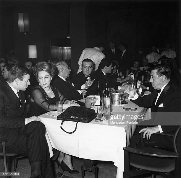 Italian publisher Arnoldo Mondadori dining with Italian actress Andreina Pagnani and French actor Fernandel They attended the Cassaforte d'Oro...
